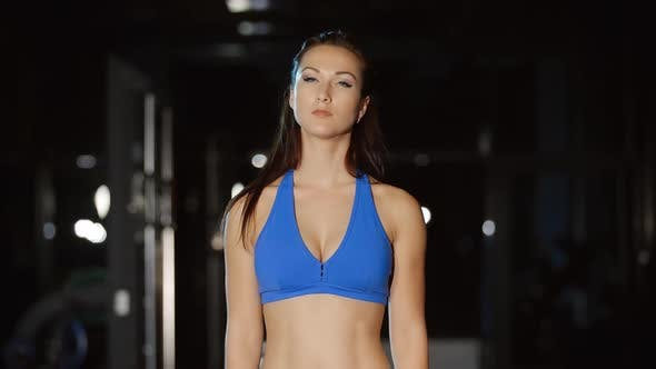 Cover Image for Woman in Blue Fitness Leggings Stretches Neck Shoulders Training