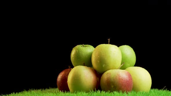 Thumbnail for Pile of shiny,vibrant apples on green rotating surface