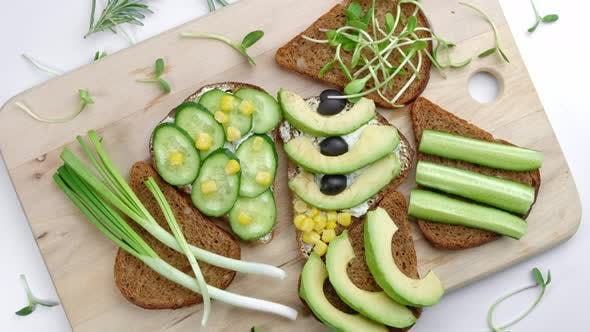 Healthy Sandwiches with Avocado Hummus Cucumber Sunflower Sprouts