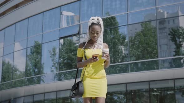 Thumbnail for Stylish Woman Using Smartphone On The Street