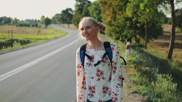 Wanderlust: Young Travelling Lady Leaves House with Backpack.