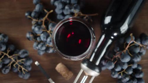 The Glass of Red Wine Rotates Slowly.