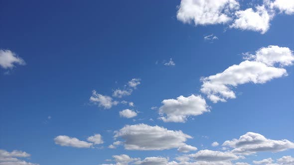 Thumbnail for Timelapse, beautiful white Clouds at blue sky background