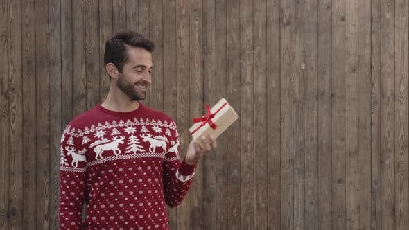 Christmas Guy Getting A Gift