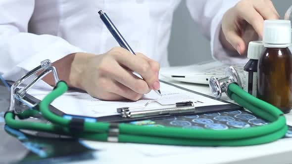 Doctor Is Engaged In Paper Work