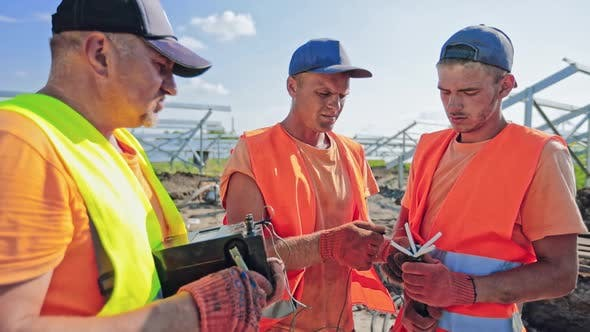 Thumbnail for Builders on solar farm