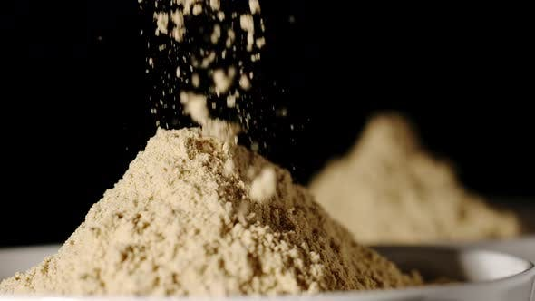 Thumbnail for SLOW MOTION:Turmeric Powder Pouring Into A White Bowl - Close Up