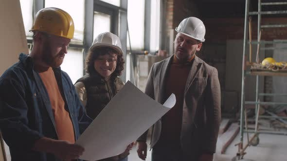 Thumbnail for Team of Architects Discussing Blueprint at Construction Site