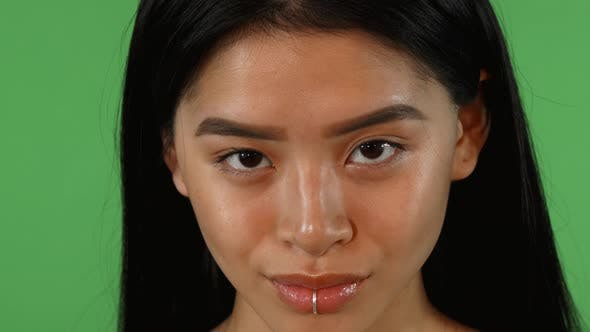 Thumbnail for Beautiful Young Asian Woman with Lip Piercing Smiling To the Camera