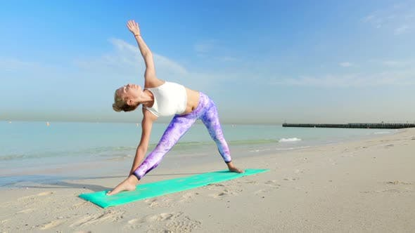 Thumbnail for Triangle Yoga Poses