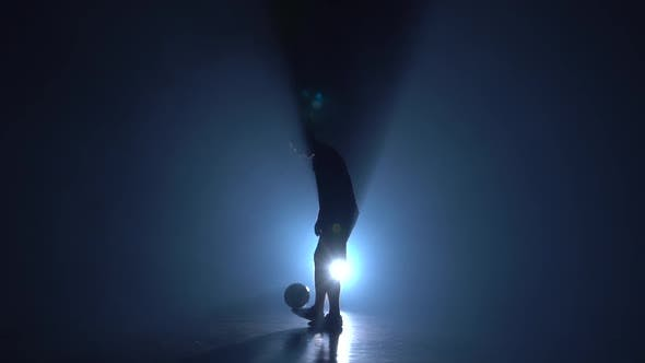 Thumbnail for Football Freestyle. Silhouette of Freestyler at Studio Against Blue Spotlight, Slow Motion
