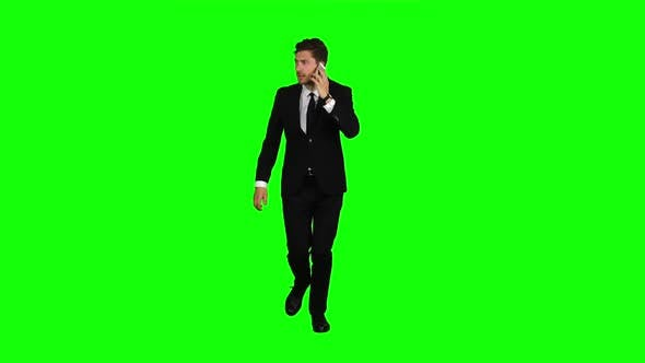 Thumbnail for Guy Rushes To Him the Phone Rings, He Starts Talking and Running. Green Screen