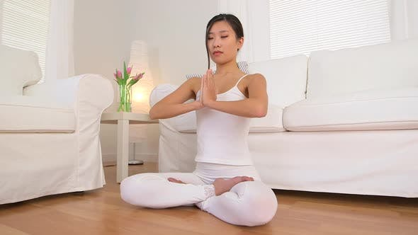 Thumbnail for Asian woman doing meditation