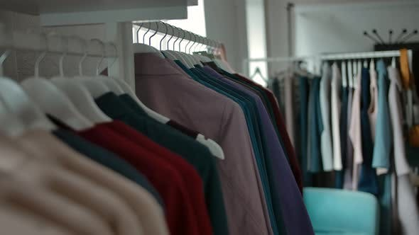 Hangers with Trendy Clothes in Shop