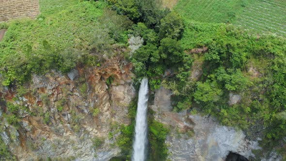 Thumbnail for Aerial slow motion: waterfall in Sumatra, travel destination in Berastagi and Lake Toba, Indonesia.