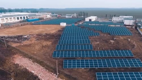 Photovoltaic solar panels on the field collect ecological energy from the sun