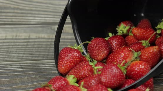 Thumbnail for Strawberries in a Small Black Bucket on the Wooden Table - Close Up