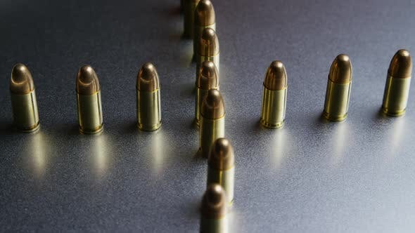Thumbnail for Cinematic rotating shot of bullets on a metallic surface - BULLETS 035