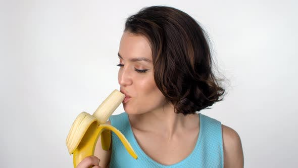 Cover Image for Young Woman Eating Banana