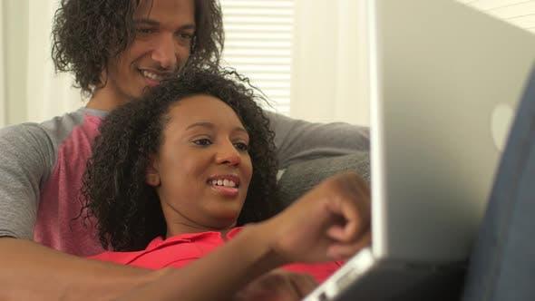 Thumbnail for Cute black couple using laptop
