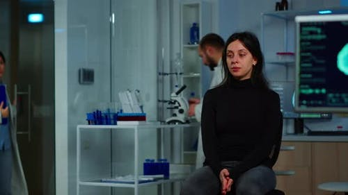 Woman Waiting Doctor Sitting on Chair in Neurological Research Lab