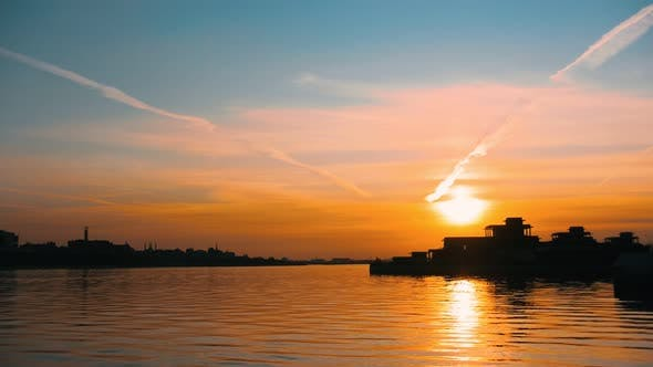 Cover Image for A Beautiful View on the Sunset Sky - the Sun Sets Over the Calm Water