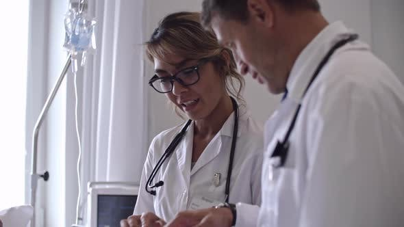 Cover Image for Doctors Using Digital Tablet while Working with Patient