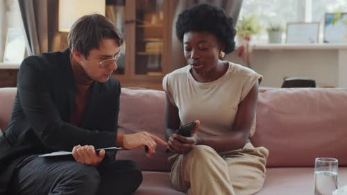 Woman Discussing Something on Smartphone with Psychologist