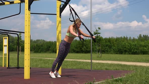 Thumbnail for A Fit Beautiful Woman Does Inclined Push-ups at an Outdoor Gym