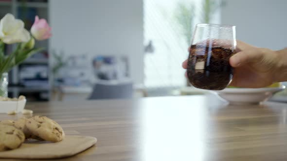 Thumbnail for Hand Takes And Put Back Glass Of Cola