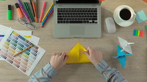 Creative Man Folding Origami at Workspace, Meditation and Inspiration, Handcraft