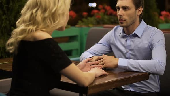 Thumbnail for Couple of Lovers Emotionally Discussing Their Relationship in Street Cafe, Date