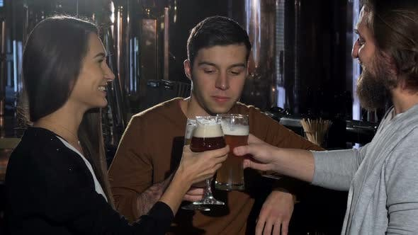 Cover Image for Group of Friends Enjoying Drinking Craft Beer at the Pub Together