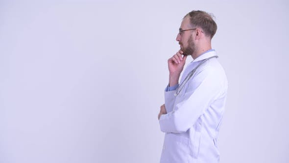 Thumbnail for Profile View of Happy Bearded Man Doctor Thinking