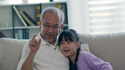 Happiness Elderly grandfather talking with grandchild together