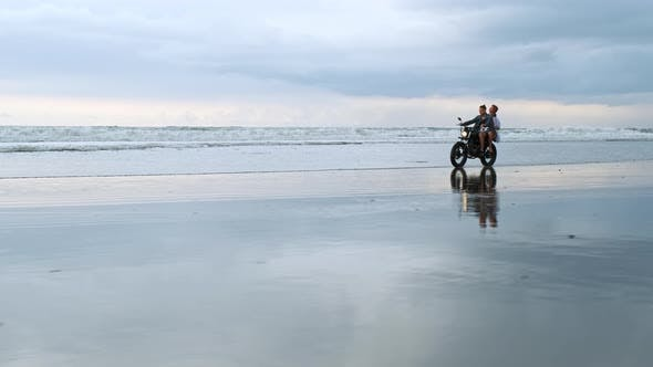 Thumbnail for Young Couple Hipsters Riding Retro Motorcycle on the Beach Outdoor Portrait Riding Guy