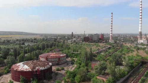 Industrial zone. Industrial plant towers. Factory chimneys. Chemical factory with pipes.