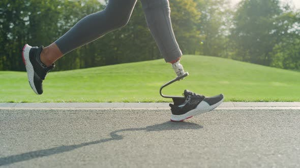 Thumbnail for Jogger with Artificial Limb Doing Cardio on Road. Athlete Running Outdoors
