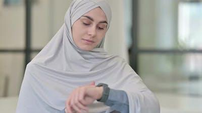 Young Arab Woman Using Smartwatch