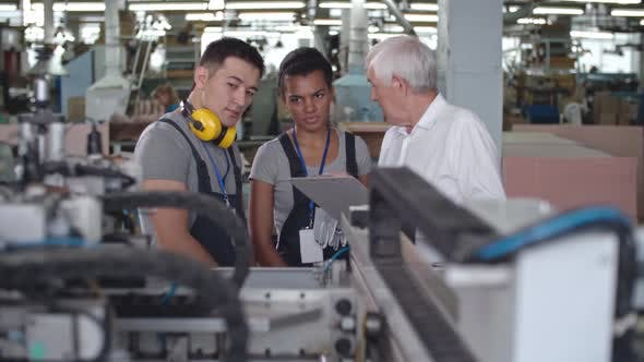 Thumbnail for Factory Workers Discussing Machinery