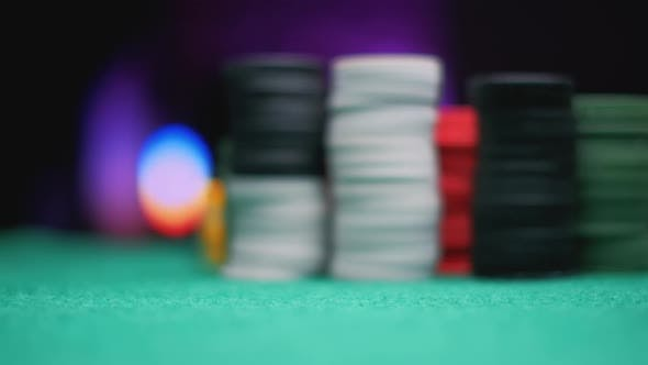 Disc Rotates in the Air Casino Chips on Green Felt