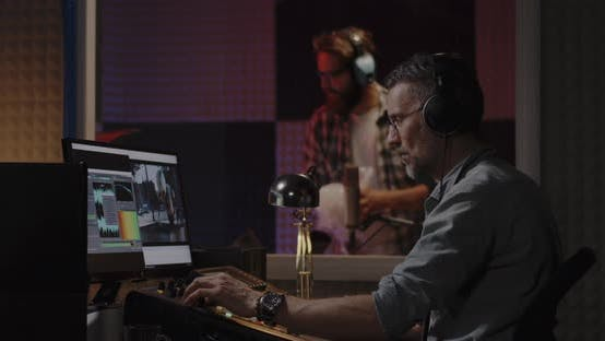 Cover Image for Foley Artist and Sound Engineer Working in Studio