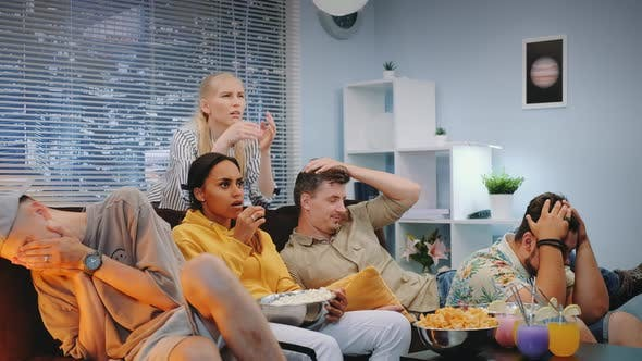 Thumbnail for Sport Fans Watching TV Together and Feeling Sad and Stressed of Match Fail