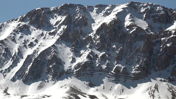 Thumbnail for Rocky Snowy Mountain Summit Under Thermal Fluctuation of Hot Weather in Sunny Spring Day
