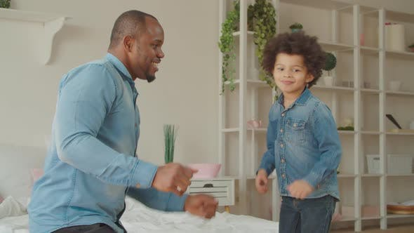 Thumbnail for Joyful Black Father and Cute Son Dancing at Home