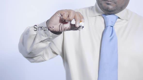 Asian Businessman Writes Stress Management