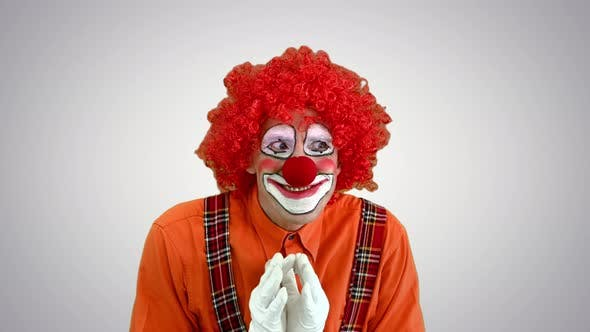 Cunning Clown Is Up To Something Having a Plan on Gradient Background.