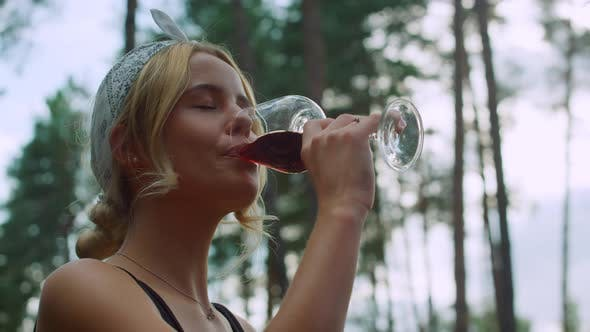Young Woman Drinking Wine Outdoors