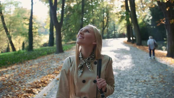 Thumbnail for Blonde Woman Walking in the Park in Autumn