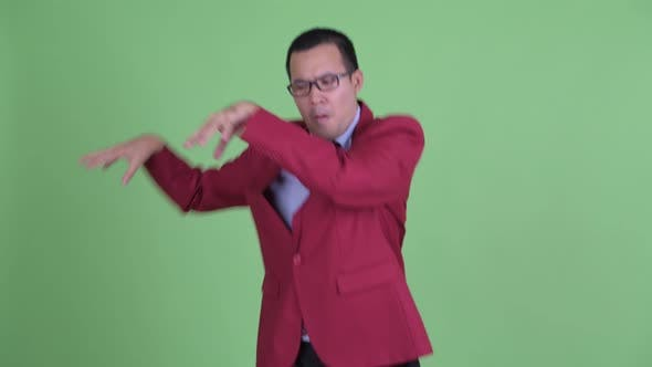 Thumbnail for Happy Asian Businessman with Eyeglasses Dancing